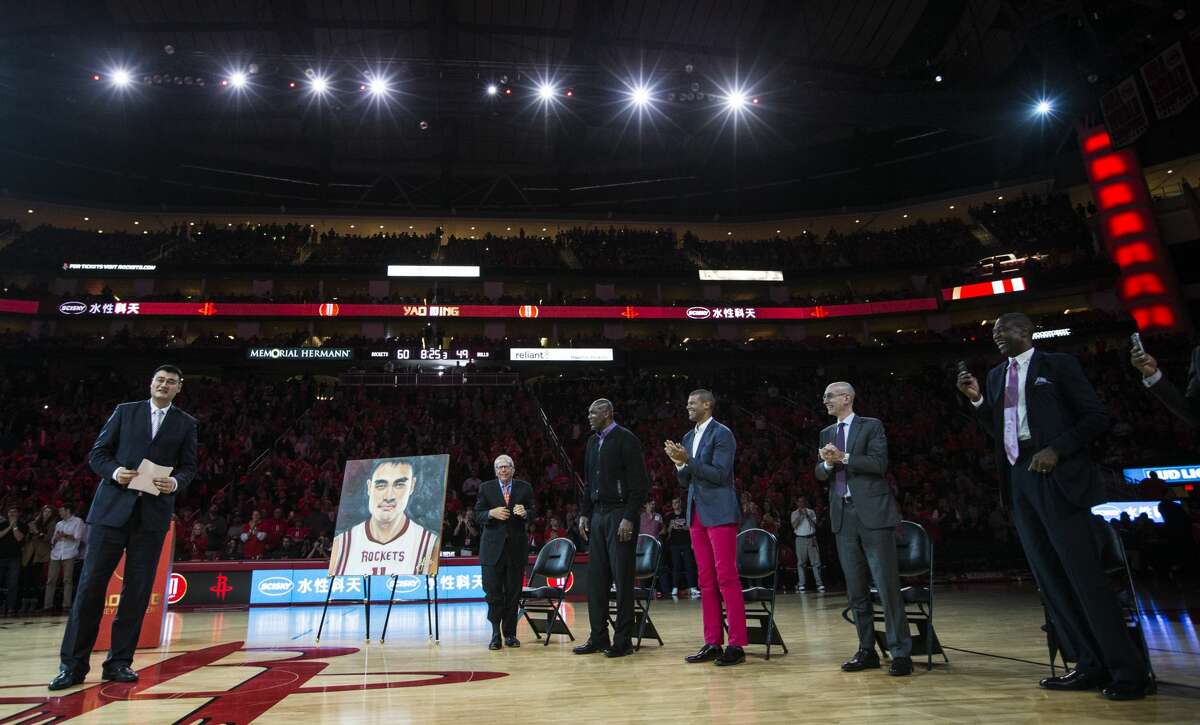Former Houston Rockets and Hall of Fame center Yao Ming stands as he is honored by the Rockets and, from left, owner, Leslie Alexander, former teammates, Hakeem Olajuwon, Shane Battier, NBA Commissioner Adam Silver, and former teammate Dikembe Mutombo duirng a halftime a halftime ceremony where Yao's number 11 jersey was retired at Toyota Center on Friday, Feb. 3, 2017, in Houston. ( Brett Coomer / Houston Chronicle )