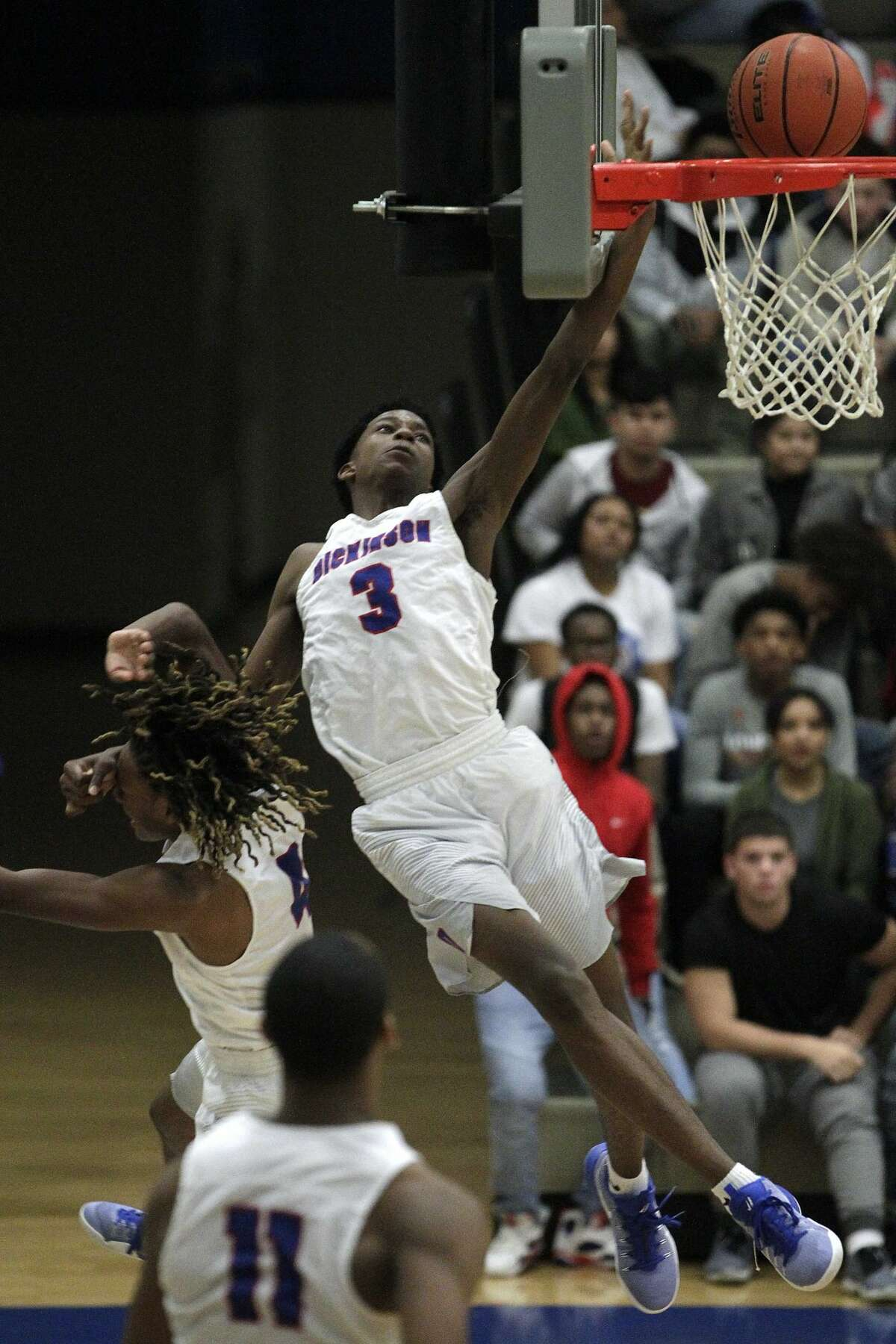 Dickinson's Tramon Mark attempts a dunk during a high school basketball game against Alvin on Friday, Feb. 3, 2017, in Dickinson. ( J. Patric Schneider / For the Chronicle )