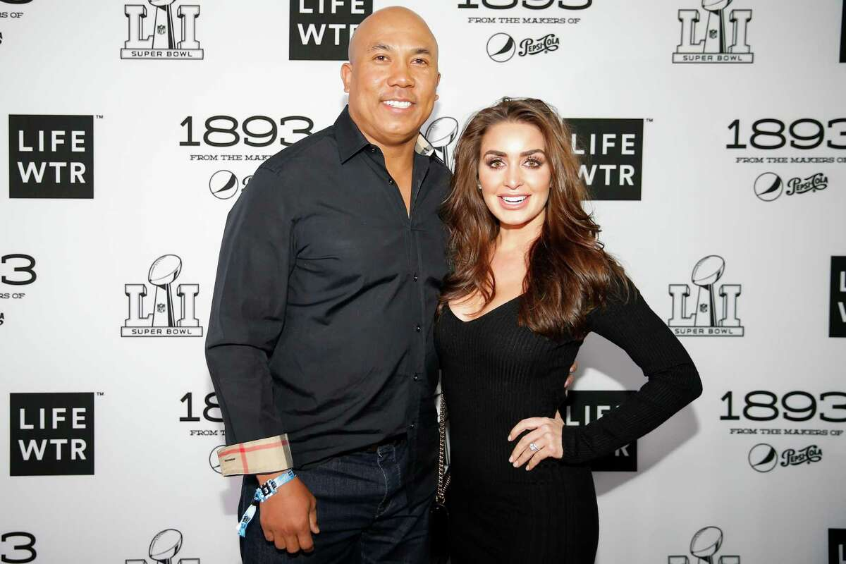 Hines Ward and his wife, Lindsey Ward, walk the red carpet before Bruno Mars performs at Club Nomadic Friday, Feb. 3, 2017 in Houston.