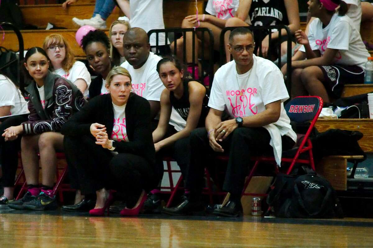 Pearland basketball coach Lauren Martens and assistant coach Andre Stokes watch as the Lady Oilers play Dawson Friday, Feb. 3 at Dawson High School.