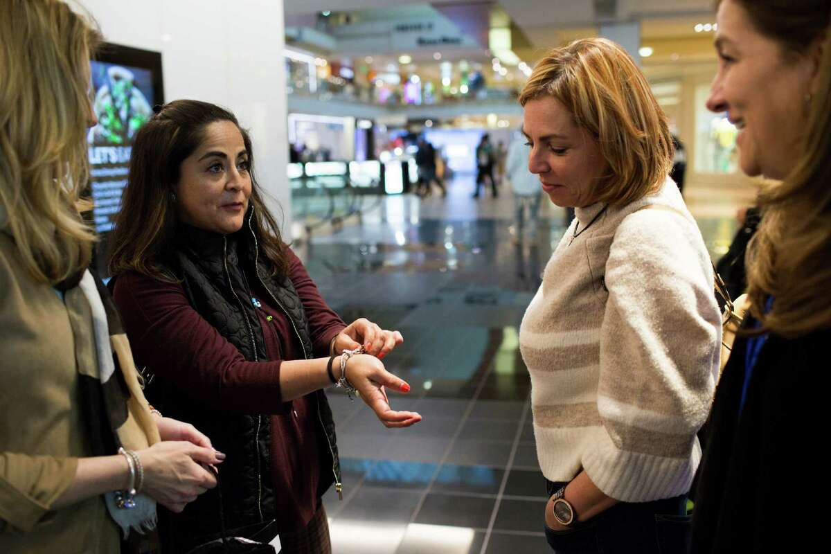 Lilliana Canseco shows her friends the collectible charm she bought for her bracelet during a trip to Houston Galleria, Friday, Feb. 3, 2017. ( Marie D. De Jesus / Houston Chronicle )