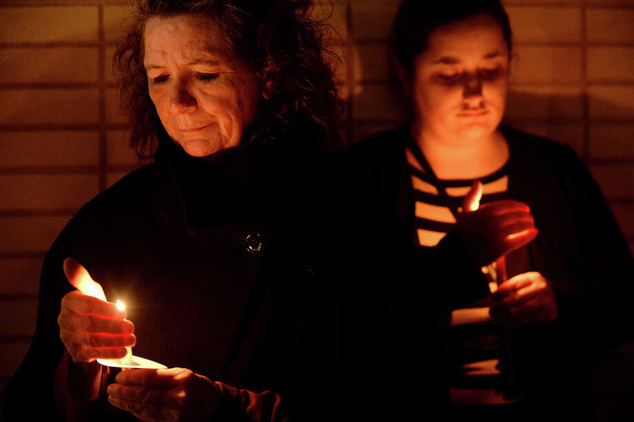 Organizer Shelby Smith and members of the community gather during Friday night's candlelight vigil to show support for refugees and immigrants in light of President Trump's executive order last week banning travel and immigration from several countries. The vigil was hosted by Golden Triangle Indivisible at the Event Centre.   Photo taken Friday, February 3, 2017 Kim Brent/The Enterprise Photo: Kim Brent / Beaumont Enterprise