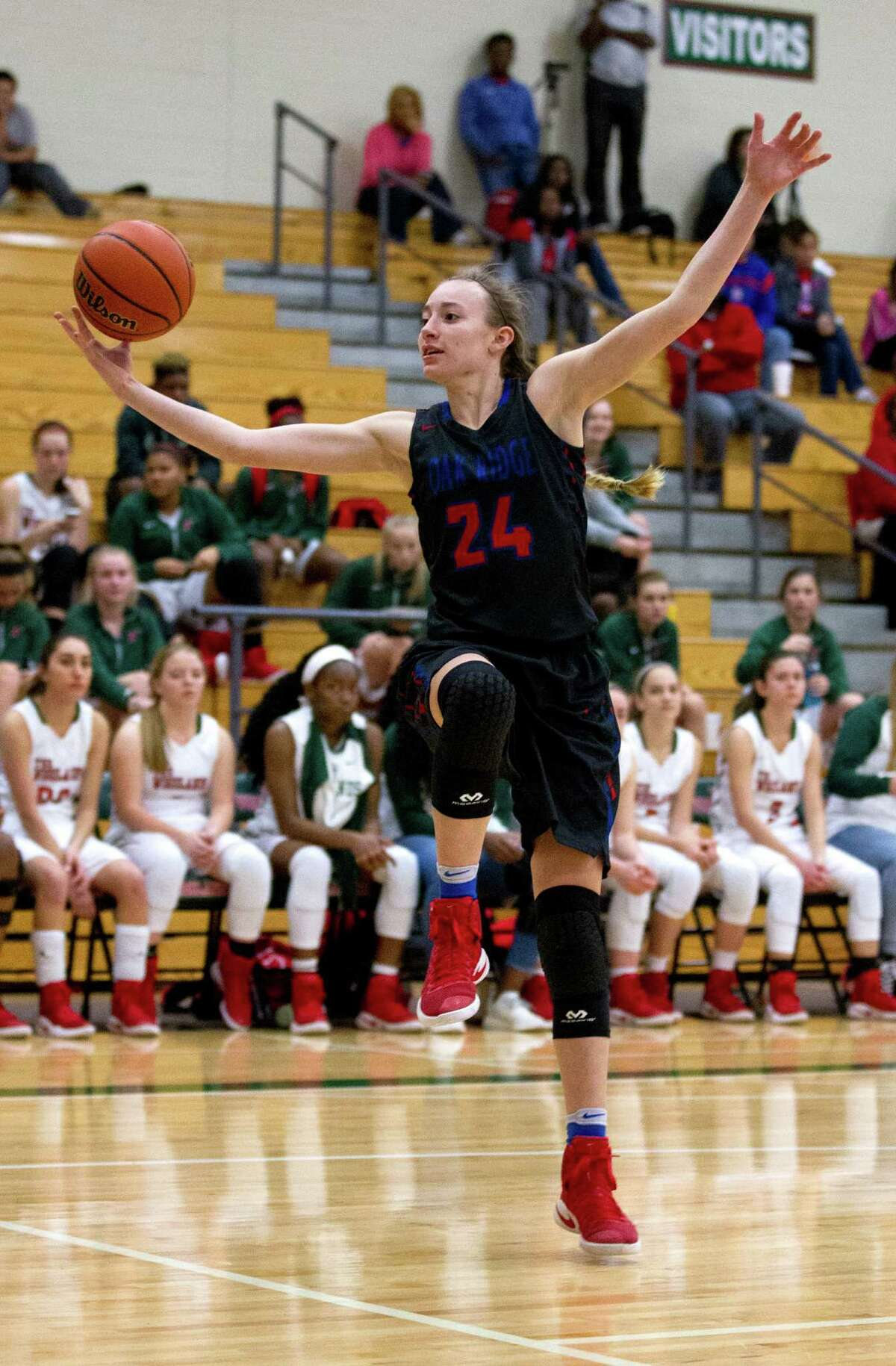 Oak Ridge power forward LaDawn Carls (24) controls a pass during the second quarter of a District 12-6A high school girls basketball game at The Woodlands High School Friday, Feb. 3, 2017, in The Woodlands. Oak Ridge defeated The Woodlands 57-47.