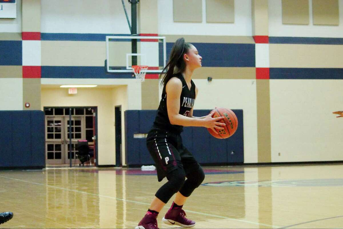 Pearland's Macey Braswell (2) looks for the open pass against Dawson Friday, Feb. 3 at Dawson High School.