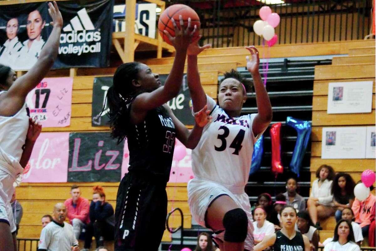 Pearland's Deyona Gaston (33) and Dawson's Amaya Bickham (34) fight for a rebound Friday, Feb. 3 at Dawson High School.