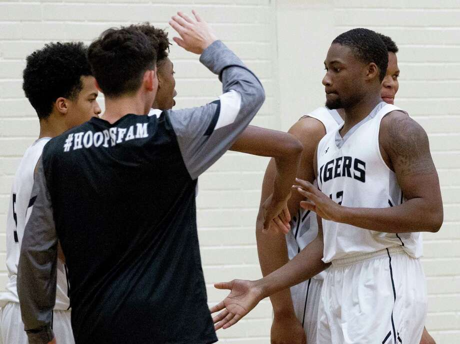 Quentin Brown slaps hands with his teammates during overtime of a District 12-6A high school boys basketball game at Conroe High School Friday, Feb. 3, 2017, in Conroe. Conroe defeated Lufkin 68-62 in overtime. Photo: Jason Fochtman, Staff Photographer / © 2017 Houston Chronicle