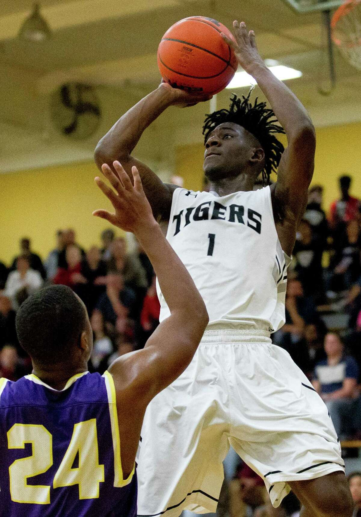 Conroe guard Jay Lewis (1) shoots over the Lufkin guard Jeremiah Davis (24) during the fourth quarter of a District 12-6A high school boys basketball game at Conroe High School Friday, Feb. 3, 2017, in Conroe. Conroe defeated Lufkin 68-62 in overtime.