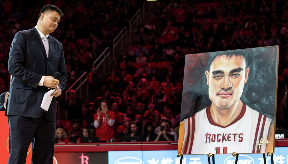 As he speaks during a halftime ceremony retiring his Rockets jersey, Hall of Fame center Yao Ming can't help but see double Friday night at Toyota Center.