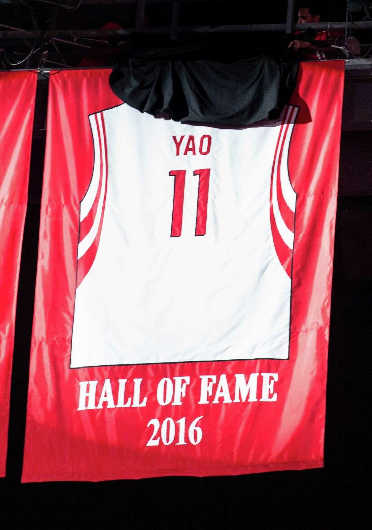 Yao Ming's No. 11 jersey joined those of six other franchise stalwarts forever on display.