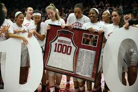 Stanford Cardinal bring a gift to head coach Tara VanDerveer following her 1,000th after an NCAA women's basketball game between the Stanford Cardinal and USC Trojans at Maples Pavillion on Friday, Feb. 3, 2017 in Stanford, Calif.