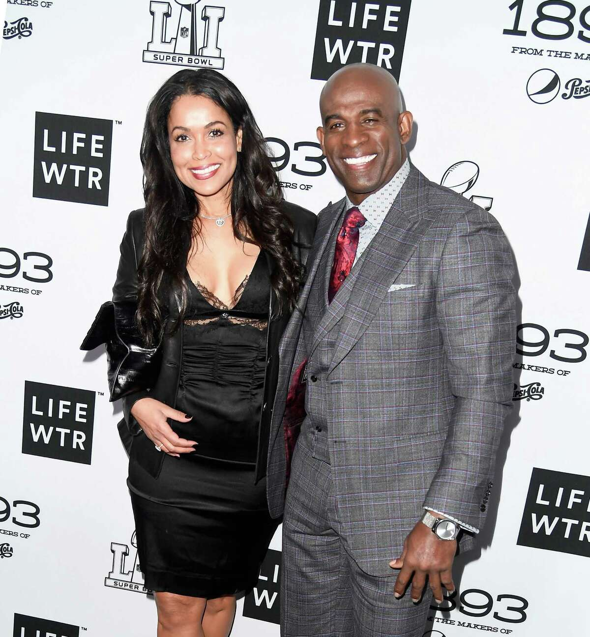 HOUSTON, TX - FEBRUARY 03: Former NFL player Deion Sanders (R) and businesswoman Tracey Edmonds attend LIFEWTR: Art After Dark, including 1893, at Club Nomadic during Super Bowl LI Weekend on February 3, 2017 in Houston, Texas.