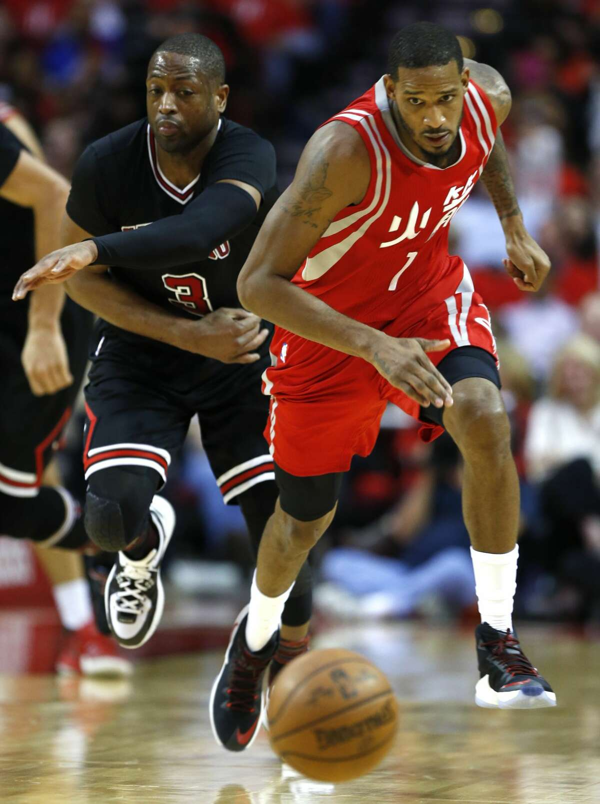 Houston Rockets forward Trevor Ariza (1) and Chicago Bulls guard Dwyane Wade (3) chase after a loose ball during the fourth quarter of an NBA basketball game at Toyota Center on Friday, Feb. 3, 2017, in Houston. ( Brett Coomer / Houston Chronicle )