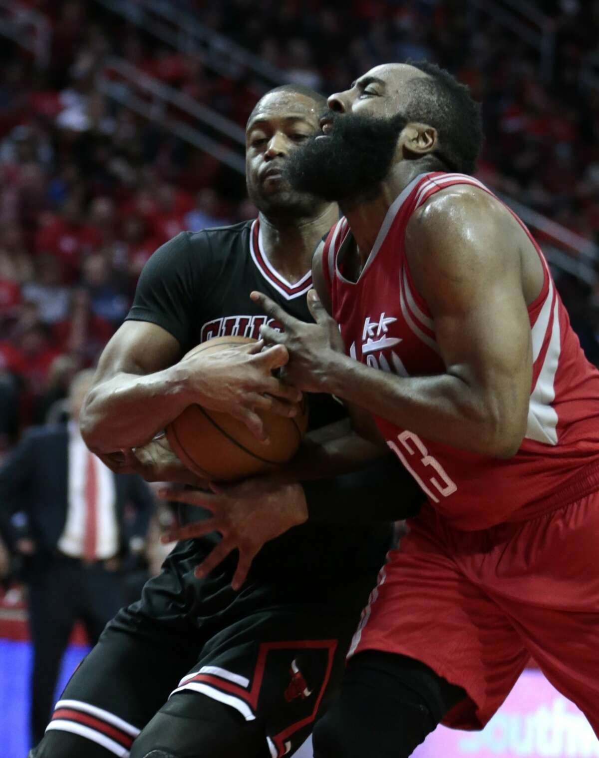 Chicago Bulls guard Dwyane Wade (3) and Houston Rockets guard James Harden (13) fight for a ball during the fourth quarter of an NBA basketball game at Toyota Center on Friday, Feb. 3, 2017, in Houston. ( Brett Coomer / Houston Chronicle )