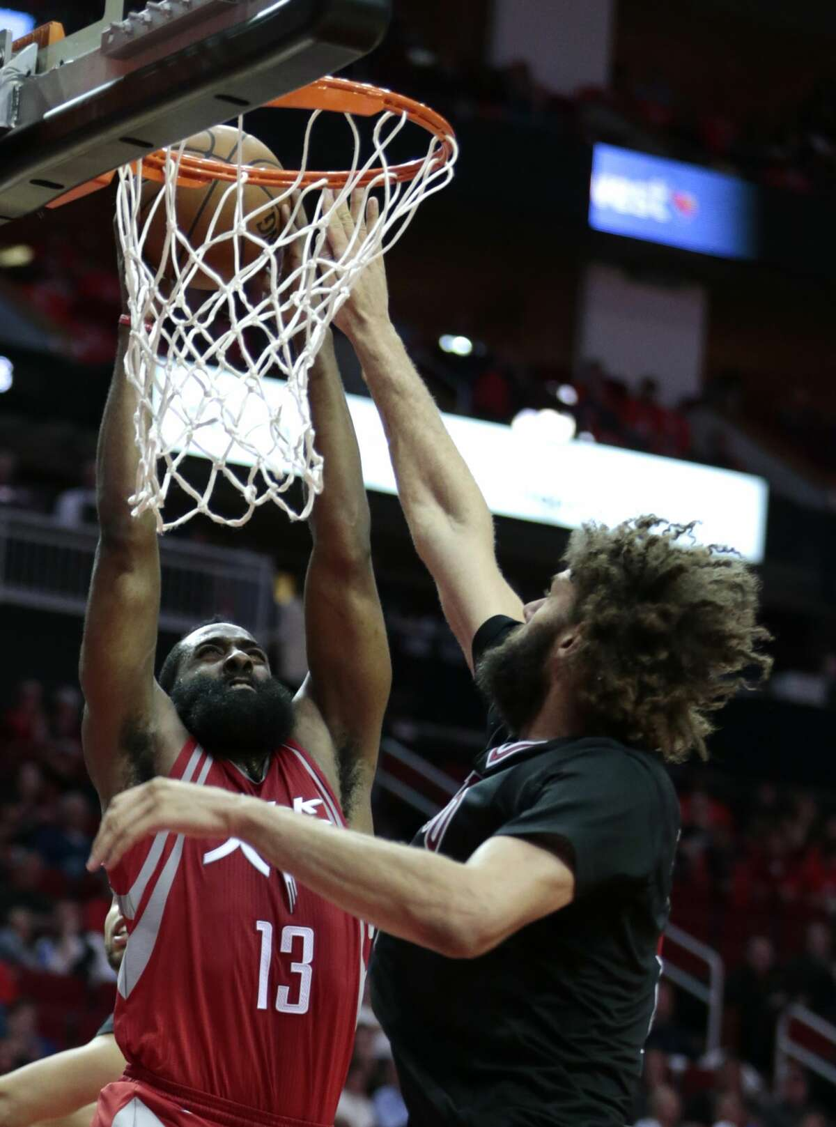 Houston Rockets guard James Harden (13) goes up for a dunk against Chicago Bulls center Robin Lopez (8) during the fourth quarter of an NBA basketball game at Toyota Center on Friday, Feb. 3, 2017, in Houston. ( Brett Coomer / Houston Chronicle )