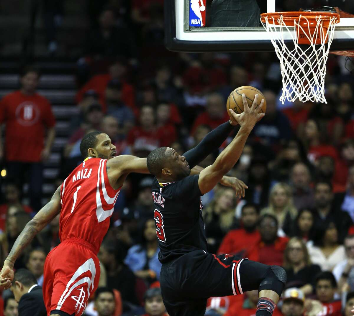 Houston Rockets forward Trevor Ariza (1) defends a drive to the basket by Chicago Bulls guard Dwyane Wade (3) during the fourth quarter of an NBA basketball game at Toyota Center on Friday, Feb. 3, 2017, in Houston. ( Brett Coomer / Houston Chronicle )