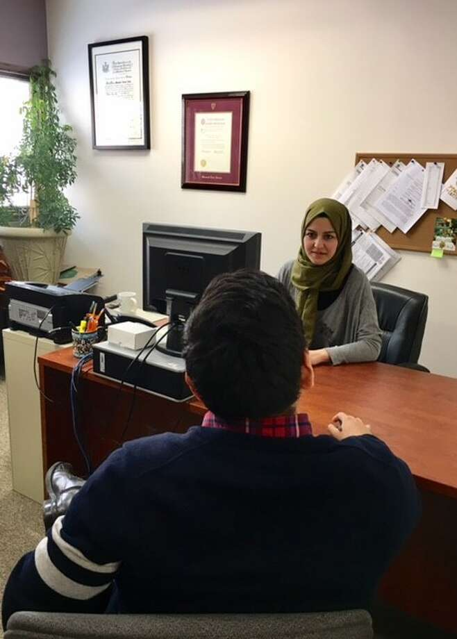 Immigration attorney Mevlude Akay works with a client at The Legal Project in Albany (Photo courtesy of The Legal Project)