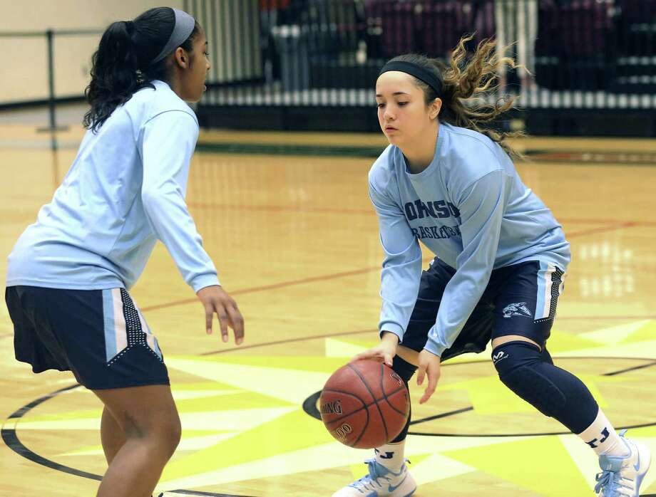Megan Valdez-Crader practices dribbling on her cousin Deja Kelly before Johnson plays Lee in girls basketball at Littleton Gym on Feb. 3, 2017. Photo: Tom Reel /San Antonio Express-News / 2017 SAN ANTONIO EXPRESS-NEWS
