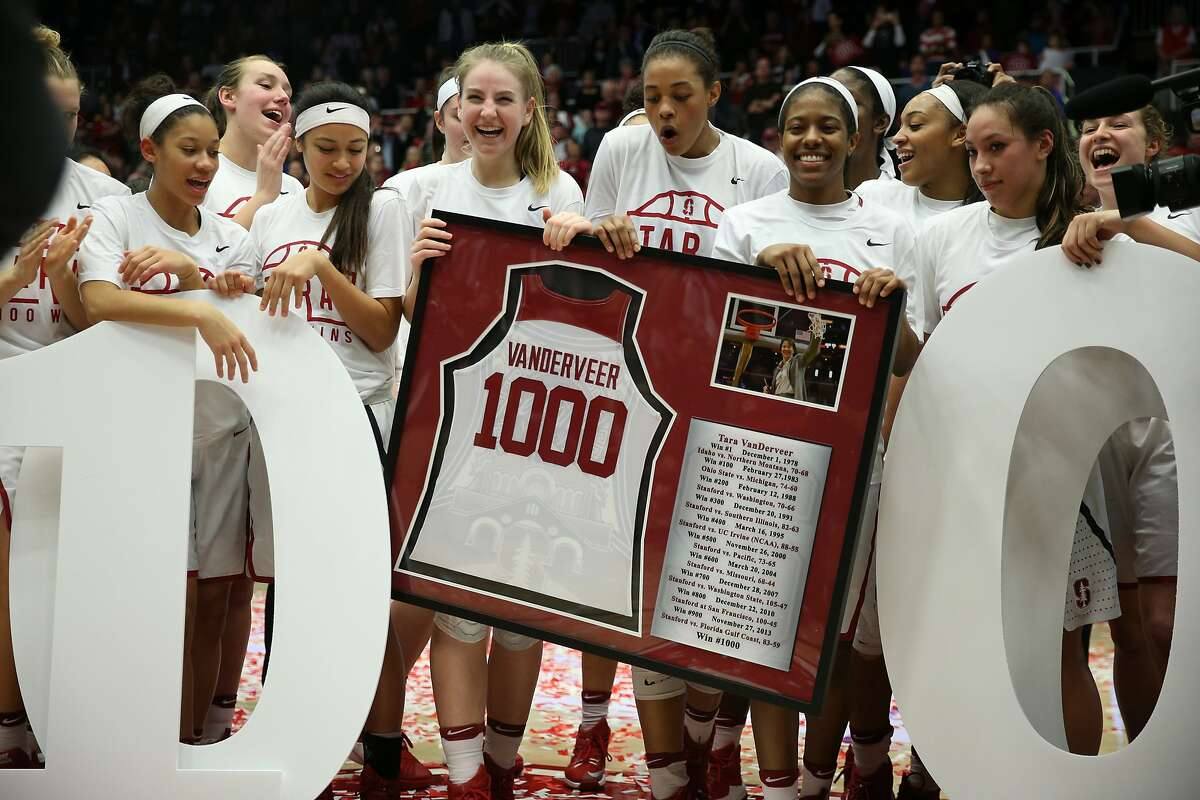 The Stanford Cardinal bring a gift to head coach Tara VanDerveer following her 1,000th after an NCAA women's basketball game between the Stanford Cardinal and USC Trojans at Maples Pavillion on Friday, Feb. 3, 2017 in Stanford, Calif.