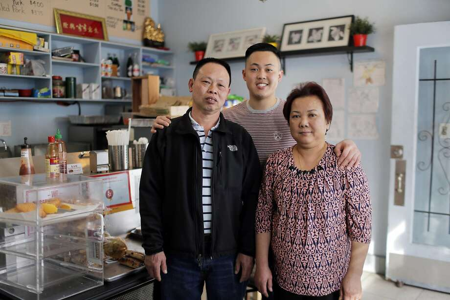 Aaron Lam, center, with his parents, Minh Lam, left, and Ki Giang, right, at the L & G Vietnamese Sandwich shop in San Francisco, Calif., on Tuesday, January 31, 2017. Minh Lam and his wife Ki Giang opened the shop several years ago as their son, Aaron, began college while still helping out around the shop. Photo: Carlos Avila Gonzalez, The Chronicle