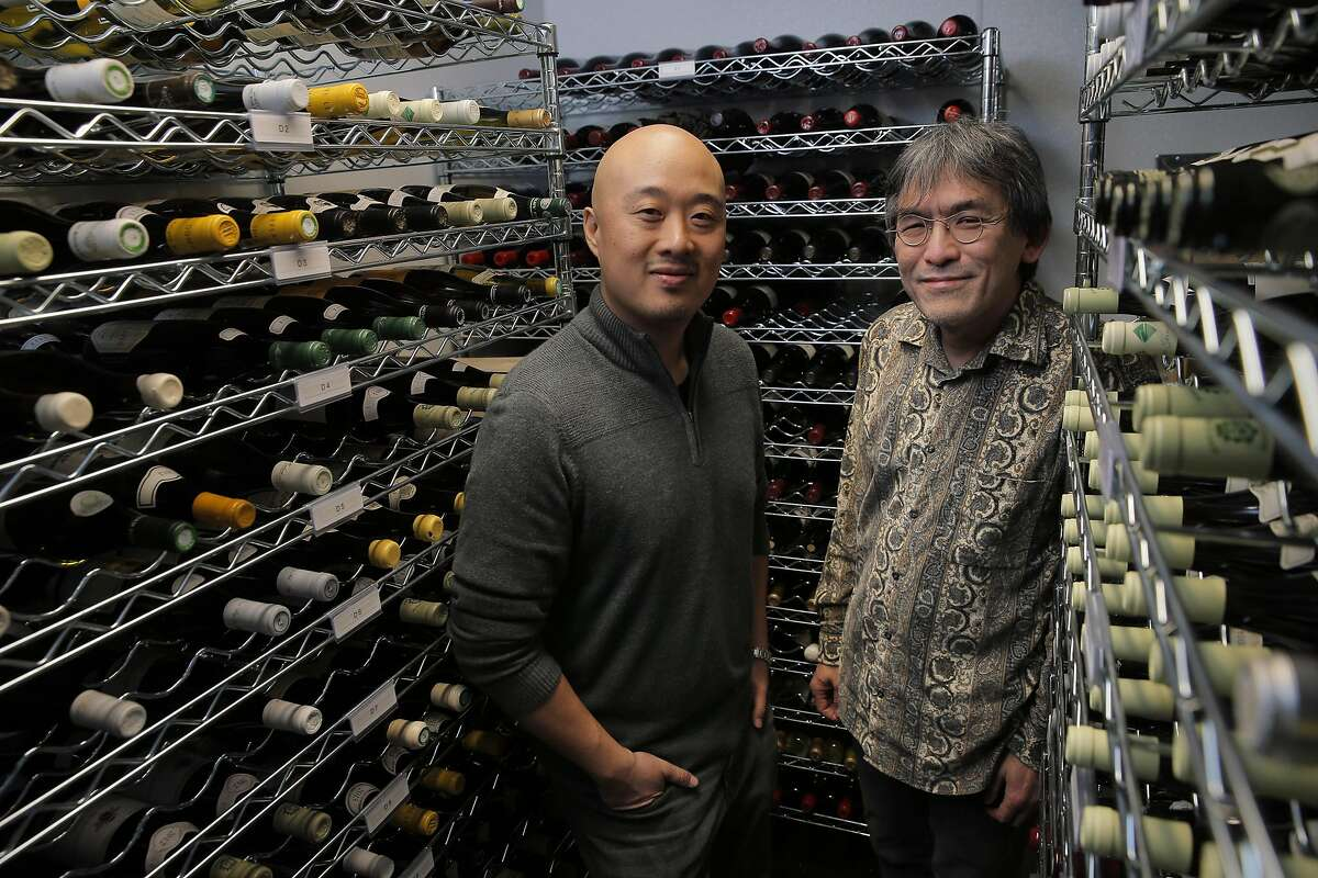 James Yu, left, and beverage director, Mark Yatabe, in the wine cellar at the Great China Restaurant in Berkeley, Calif., on Tuesday, January 31, 2017. The Great China Restaurant has been around for generations, and James Yu, the current owner, has a passion for wine and transformed the restaurant into one of the Bay Area's greatest hidden gems for wine -- especially wine from his favorite region, Burgundy. A fire destroyed the restaurant a few years ago, and the magnificent cellar that Yu had taken years to compile was suddenly gone. It's taken Yu a while to recreate the wine cellar, but now, he's finally ready to debut the new list -- and it's even better than it was before.