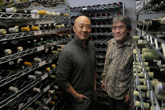 James Yu, left, and sommelier, Mark Yatabe, in the wine cellar at the Great China Restaurant in Berkeley, Calif., on Tuesday, January 31, 2017. The Great China Restaurant has been around for generations, and James Yu, the current owner, has a passion for wine and transformed the restaurant into one of the Bay Area's greatest hidden gems for wine -- especially wine from his favorite region, Burgundy.  A fire destroyed the restaurant a few years ago, and the magnificent cellar that Yu had taken years to compile was suddenly gone. It's taken Yu a while to recreate the wine cellar, but now, he's finally ready to debut the new list -- and it's even better than it was before.