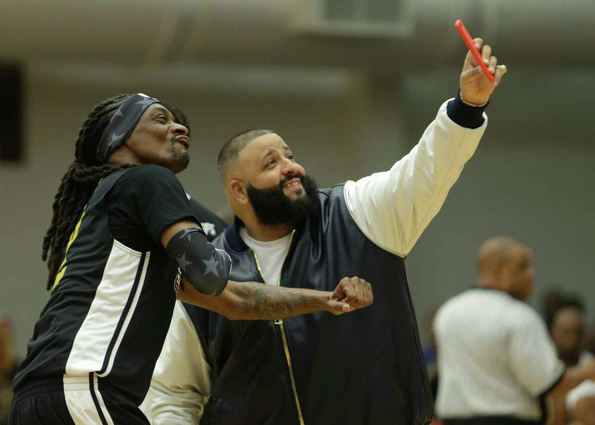 Snoop Dogg poses for a photo with DJ Khaled during the DraftKings Antonio Brown Celebrity Slam Basketball Game benefiting the Boys and Girls Club of Greater Houston at the Joe K. Butler Sports Complex, Friday, Feb. 3, 2017, in Houston.