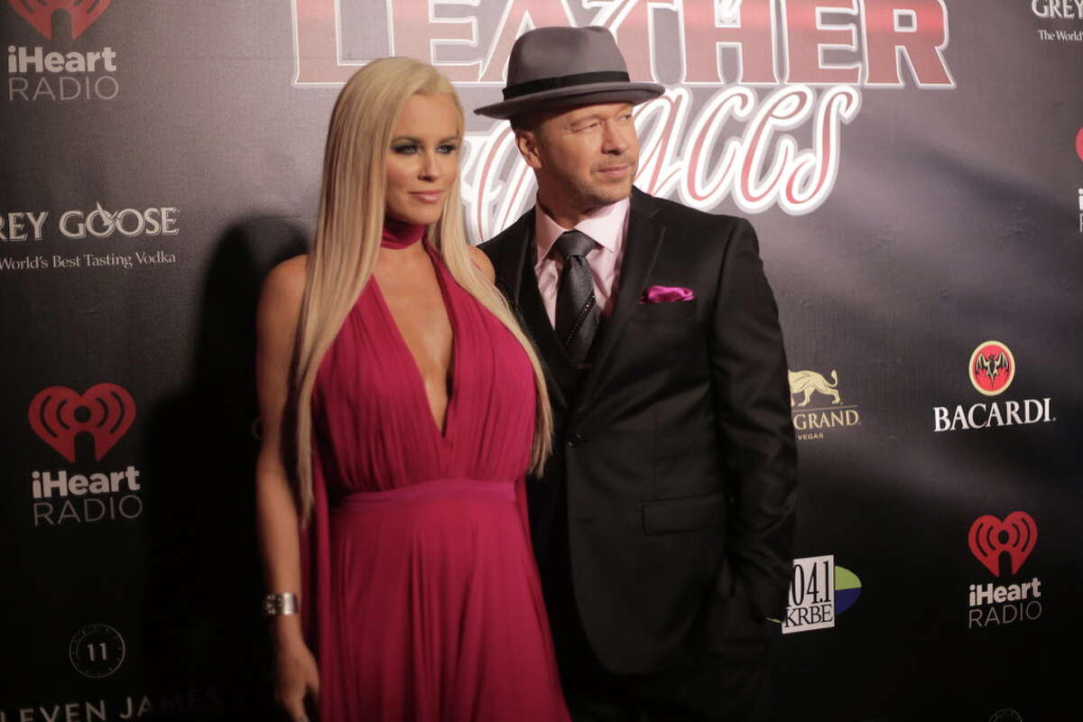 Jenny McCarthy and Donnie Wahlberg stop on the red carpet for Leather & Laces party they hosted on Friday, Feb. 3, 2017, in Houston.