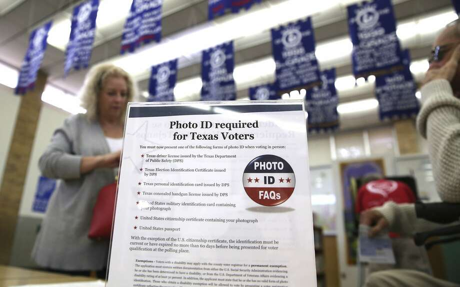A sign last March at a polling center in Arlington, Texas, describes voter identification requirements. Photo: LM Otero, Associated Press