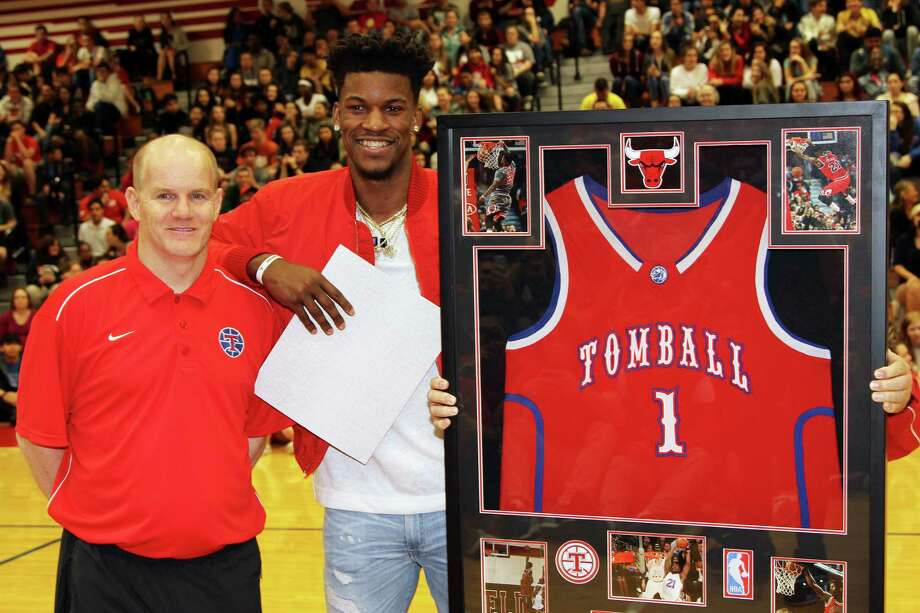 2007 Tomball graduate, and current Chicago Bulls All-Star guard, Jimmy Butler stands beside Tomball High School Basketball head coach Brad Ball. Butler's No. 1 high school jersey was retired Thursday, and Butler said that he has never forgotten his roots, nor what he owes to the citizens of Tomball for their unceasing support. Photo: Tomball ISD Communications