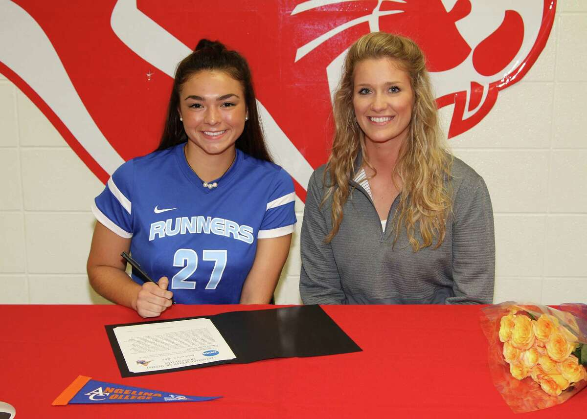 Tomball High School Varsity Girls Soccer senior center midfielder Olivia Urrutia (left) sits aside assistant coach Brooke Neal (right) during her National Signing Day ceremony at Tomball High School Wednesday. Urrutia, an All-Distrst, Academic All-District and TASC All-State player, signed her National Letter of Intent to play soccer for Angelina College.