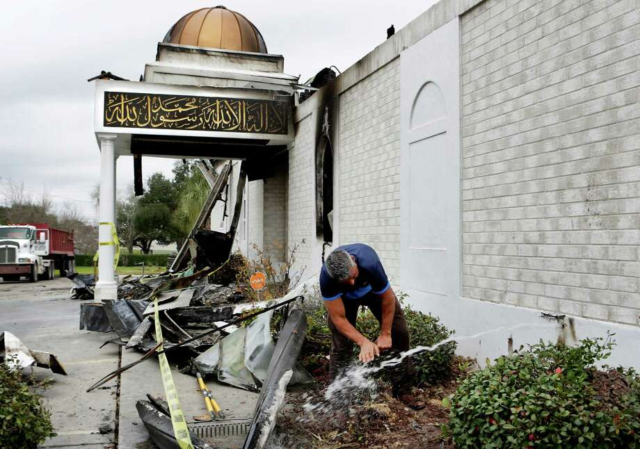 When a gush of water started flowing from a broken water line from the mosque, Shahid Hashmi, President of the Victoria Islamic Center rushed over to wash his hands before going to a prayer service on Tuesday, Feb. 2, 2017. Photo: Bob Owen, San Antonio Express-News / ©2017 San Antonio Express-News