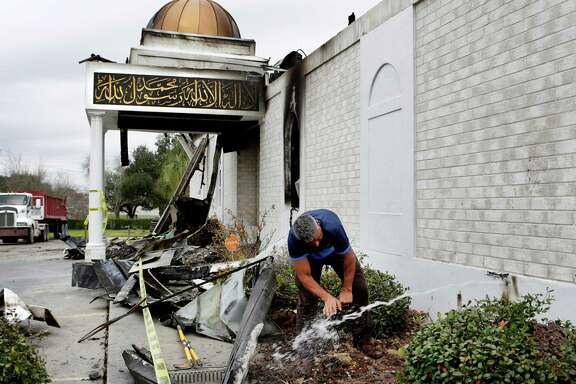 When a gush of water started flowing from a broken water line from the mosque, Shahid Hashmi, President of the Victoria Islamic Center rushed over to wash his hands before going to a prayer service on Tuesday, Feb. 2, 2017.