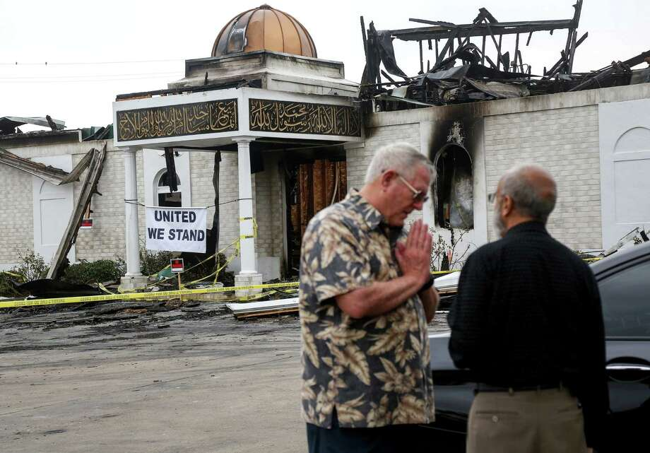 Bill Pozzi, left, who was a district-level delegate to the 2016 Republican National Convention, offers his help and condolences  to Shahid Hashmi, the president of the Victoria Islamic Center, Thursday, Feb. 2, 2017, in Victoria. An overnight fire destroyed the center on Jan. 28. Photo: Jon Shapley, Houston Chronicle / © 2017  Houston Chronicle