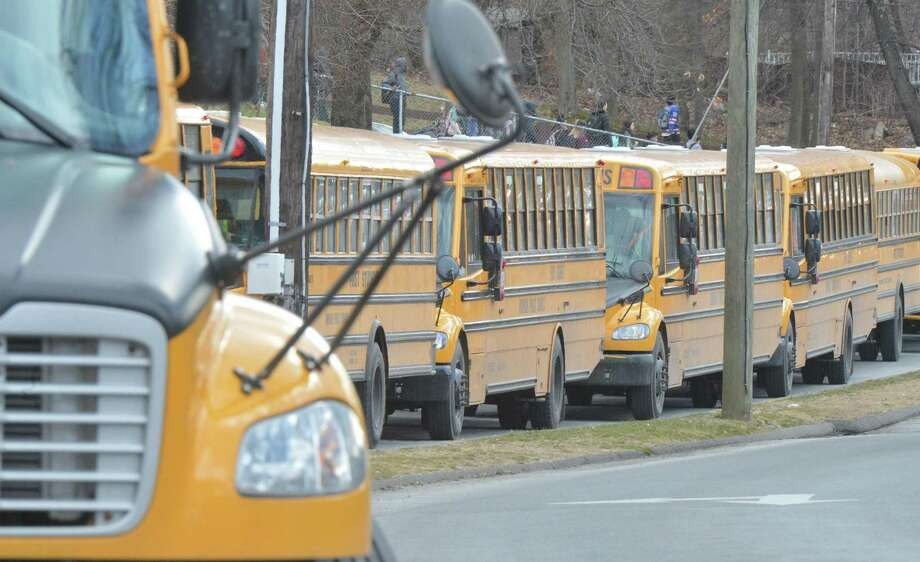 Buses line up on Strawberry Hill Ave. to pick up students after school at Norwalk High School on Thursday February 2, 2017 in Norwalk Conn Photo: Alex Von Kleydorff / Hearst Connecticut Media / Connecticut Post
