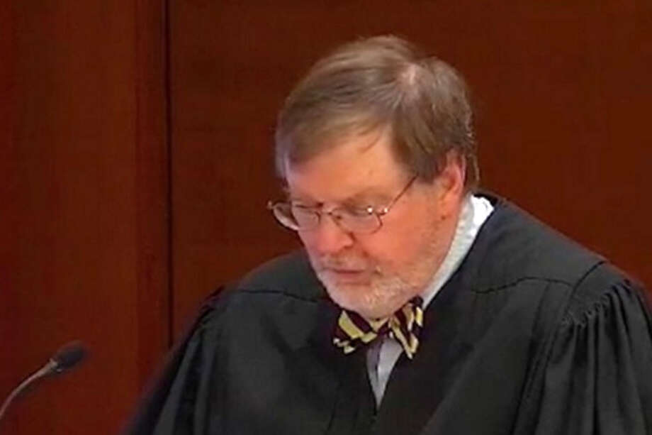 Judge James Robart reads his decision granting the states of Washington and Minnesota a temporary restraining order, blocking President Trump's Travel Ban No. 1, on immigration, Friday, Feb. 3, 2017.