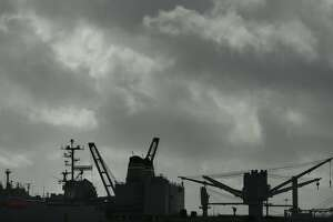 Storm clouds drift over the USS Hornet (12) and other ships on Friday, Feb. 3, 2017, in Alameda, Calif. The San Francisco Bay Area is expecting more rain storms in the area over the weekend. (AP Photo/Ben Margot)