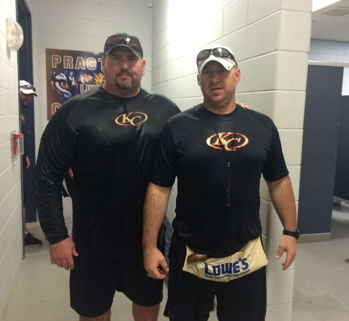 Klein Collins' Jim Scott (left) stands aside Mike Troutman (right) in a photograph from before his cancer diagnosis. Tigers head football coach Drew Svoboda elevated Troutman to offensive line coach in Scott's stead as he became progressively more ill. Troutman says that the offensive line's success this past season - arguably one of the best in the state - was entirely due to Scott, whom he called, 'the cornerstone' and 'a rock.'