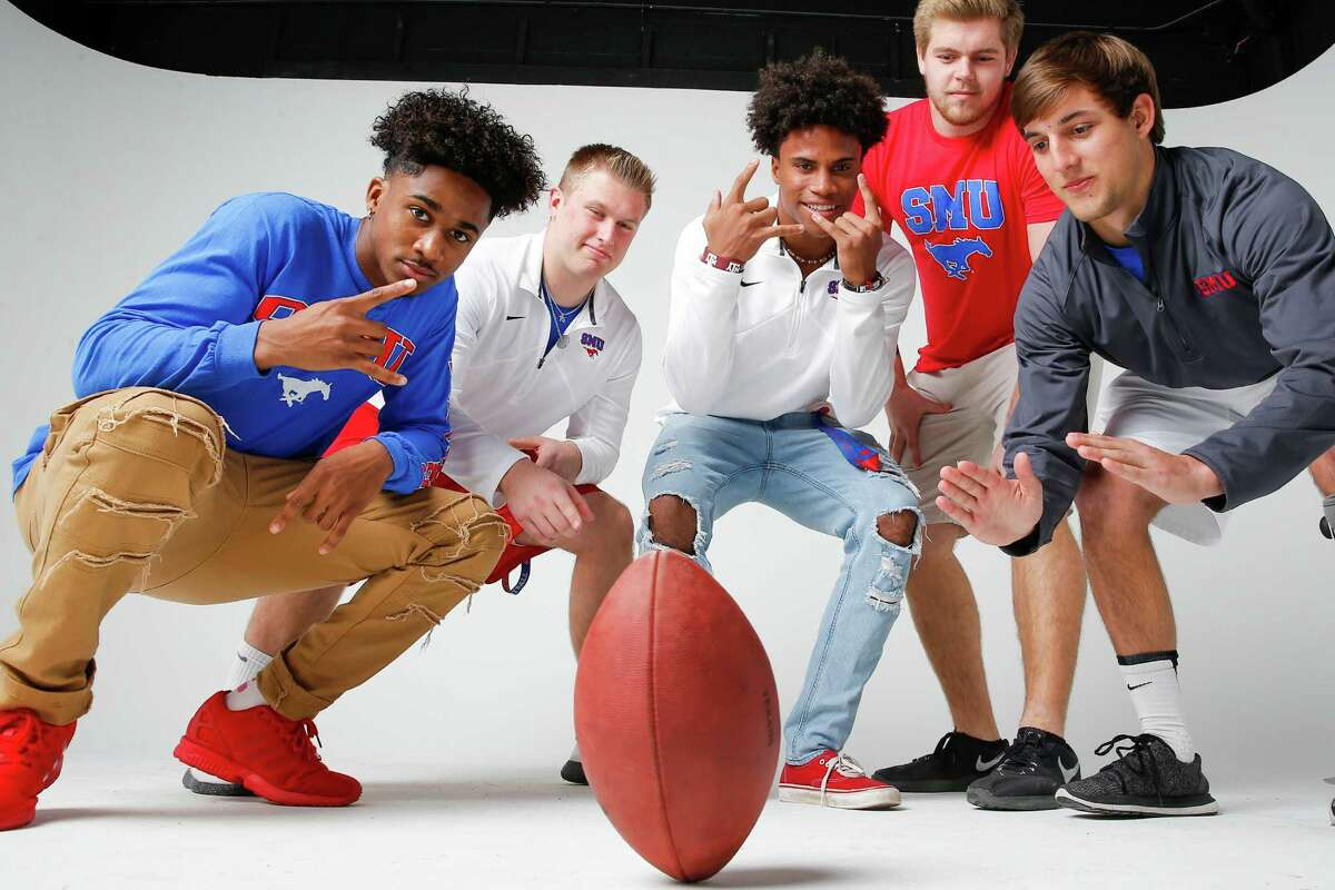 SMU committed football players, from left, Ar'mani Johnson, Hayden Howerton, Justin Guy-Robinson, Harrison Loveless and Tyler Page pose for a portrait Sunday, Jan. 22, 2017 in Houston.