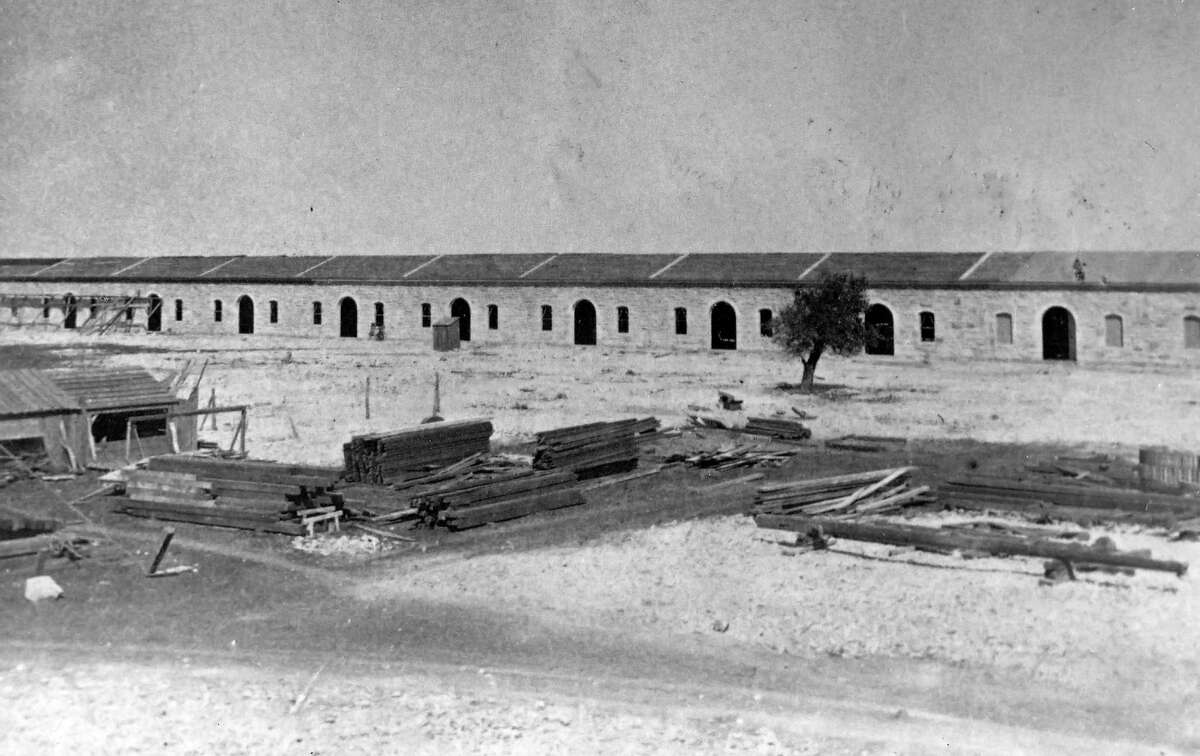 The Quadrangle at Fort Sam Houston - shown here under construction circa 1879 - was less than a decade old when Army Capt. Bainbridge Reynolds was assigned to the post.