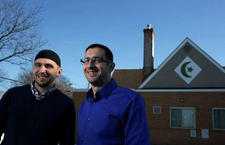Imam Jasmin Suljkanovic, left, and Enes Gluhic are members of the Islamic Community of Bosniaks in Minneapolis, Minn.