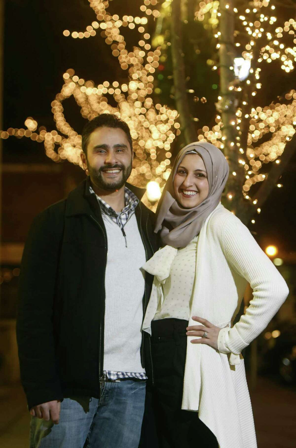 Stamford residents Shaimah Hamdan and her husband Fadi El-Ghussein pose near their home in downtown Stamford, Conn. Thursday, Jan. 19, 2017. The young couple has been living in Stamford for two years, moving to the area from New Hampshire for Fadi's job.