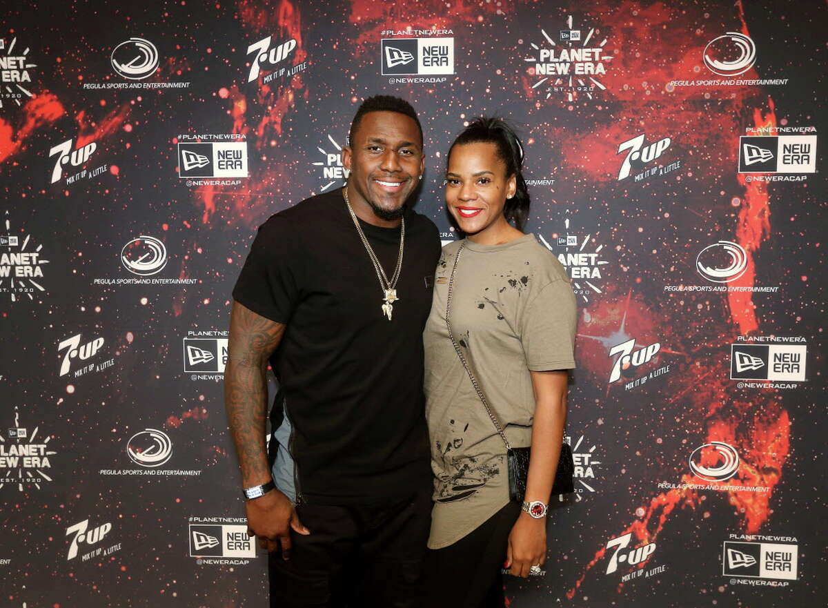 Carolina Panthers linebacker Thomas Davis (58), left, and his wife Kelly Davis pose for a photo on the red carpet at the Planet New Era party, Friday, Feb. 3, 2017, in Houston.