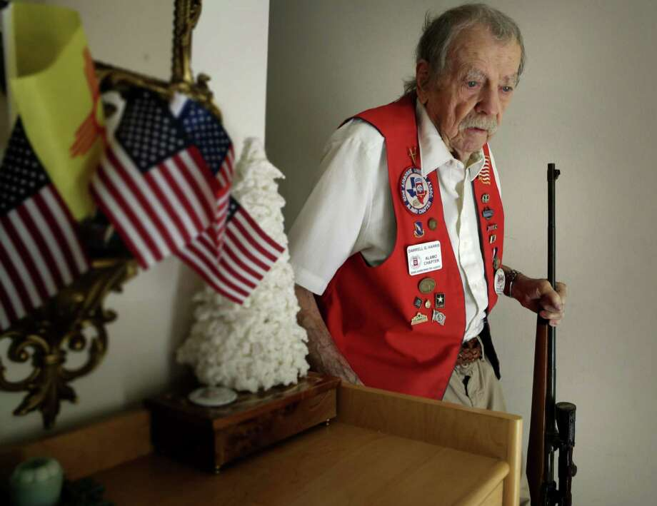 WWII vet Darrell Harris brought home a German rifle that he put a different stock on and used as a deer hunting gun. Photo: Bob Owen /San Antonio Express-News / ©2017 San Antonio Express-News