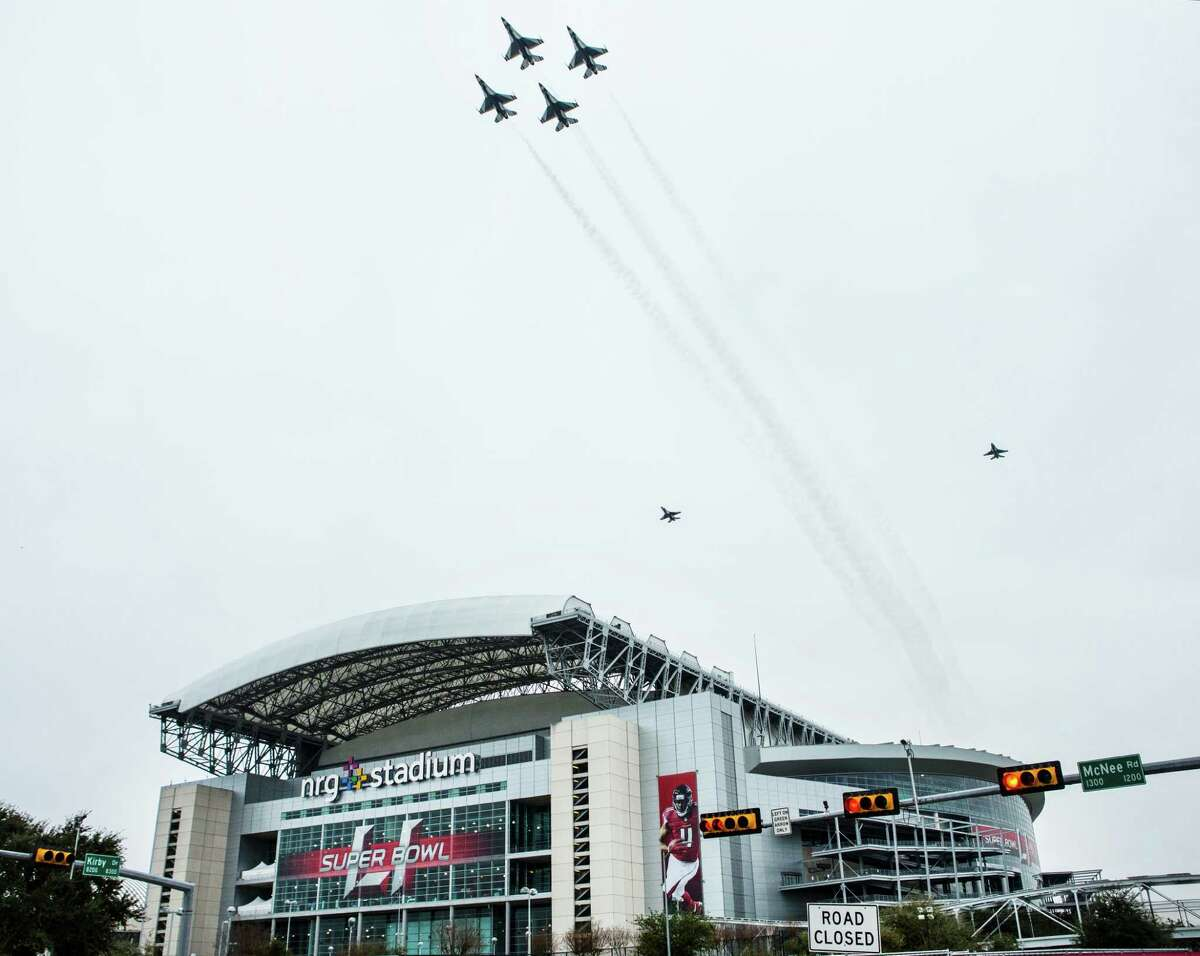 The U.S. Air Force Thunderbirds fly over NRG Stadium as a rehearsal for Super Bowl LI on Saturday in Houston. >>Keep clicking for a look at the most memorable Super Bowl half-time shows of all time.