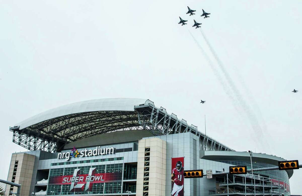 The U.S. Air Force Thunderbirds fly over NRG Stadium as a rehearsal for Super Bowl LI on Saturday, Feb. 4, 2017, in Houston.