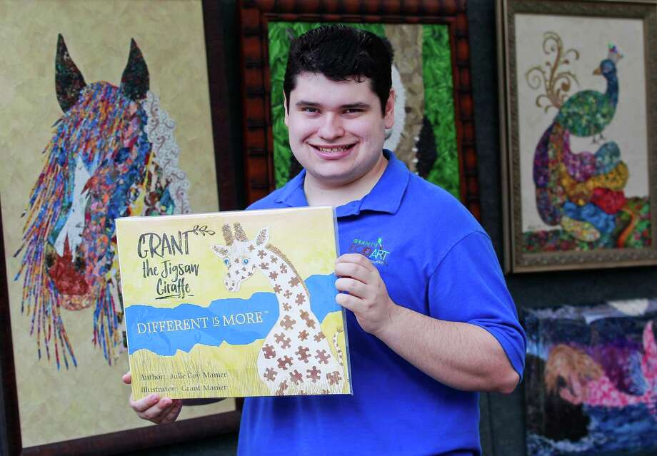 Grant Manier, a 21-year-old autistic Woodlands resident, illustrated the childrené•s book 'Grant the Jigsaw Giraffe' his mother authored about a giraffe who is different. Photo: Jason Fochtman, Staff Photographer / © 2017 Houston Chronicle