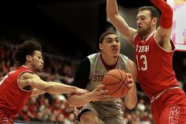 Stanford's Reid Travis, center, looks to shoot between Utah's Devon Daniels, left, and David Collette, right, during the first half of an NCAA college basketball game Saturday, Feb. 4, 2017, in Stanford, Calif. (AP Photo/Ben Margot)