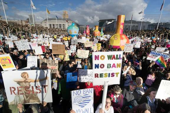 Crowds gather at the Civic Center Plaza on Saturday, Feb. 4, 2017 in San Francisco, CA  Protest against trump plan for wall on Mexican border and ban on immigrants and visitors from a number of mainly Muslim countries at the Civic Center Plaza.  Organizers are calling it a peaceful protest expected to draw more than 6,000 people.