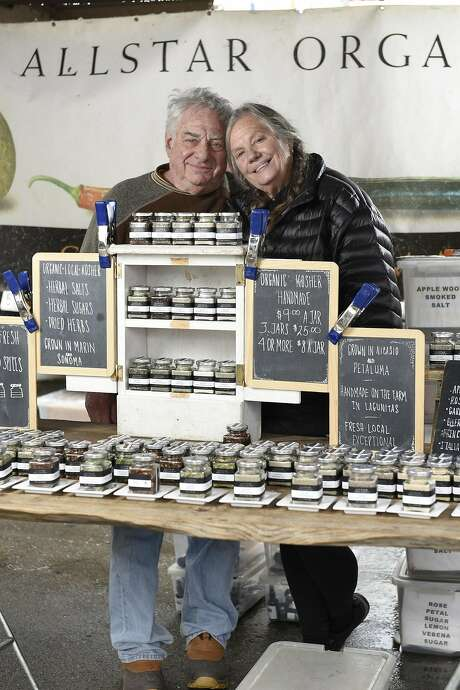 Marty Jacobson and Janet Brown of All Star Organics sell heirloom produce at their booth at the Ferry Plaza Farmers Market. Photo: Michael Short, Special To The Chronicle