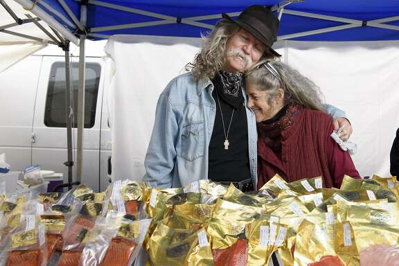 Mike and Sally Hiebert of Cap'n Mike's Holy Smoke Salmon pose for a portrait in their booth at the Ferry Plaza Farmer's Market in San Francisco, CA on Saturday, February 4, 2017.